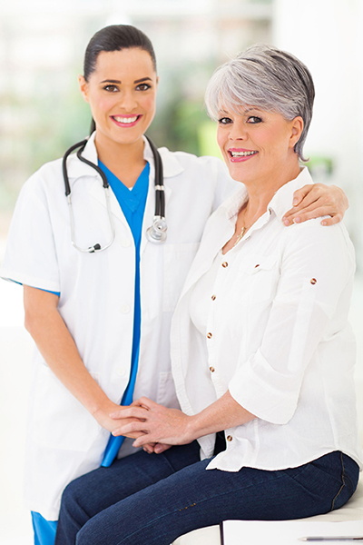 Elora Power caring nurse comforting middle aged patient in office